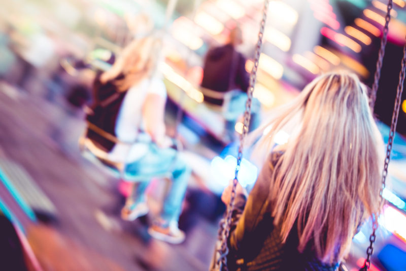 woman-on-carousel-swing-ride-picjumbo-com